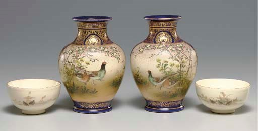A Pair of Earthenware Vases an