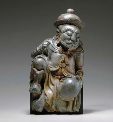 A RARE WOOD FIGURE OF A FOREIG