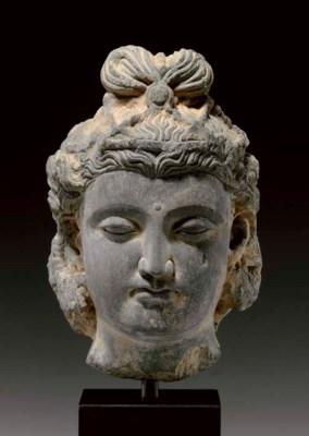 A gray schist head of Maitreya