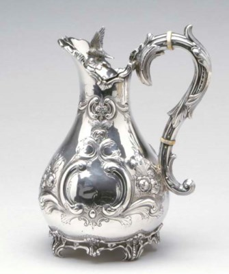 AN IRISH SILVER JUG AND COVER*