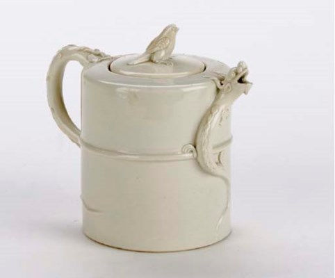 A BLANC-DE-CHINE TEAPOT AND CO