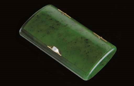 A JEWELED AND GOLD NEPHRITE BO