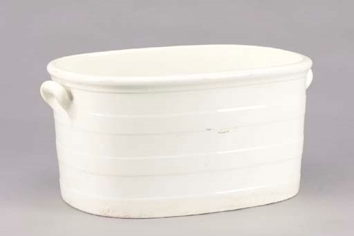 A VICTORIAN CREAM GLAZED EARTH