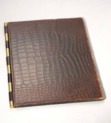 A BROWN CROCODILE AND LEATHER