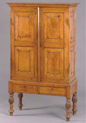 A CONTINENTAL WALNUT CABINET O