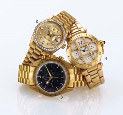 ROLEX. AN 18K GOLD AND LATER-A