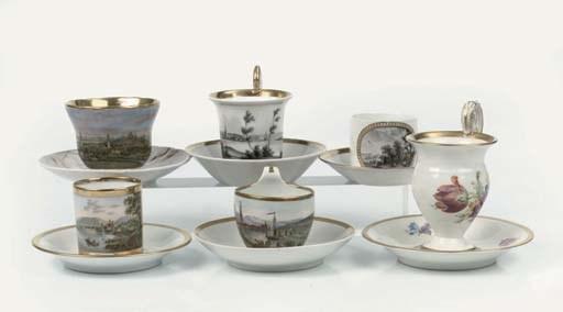 Six German porcelain gilt cabi