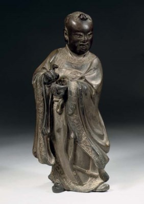 A lacquered wood figure of a y