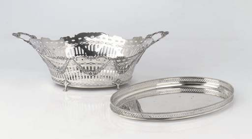 A Dutch silver bread-basket and an oval tray