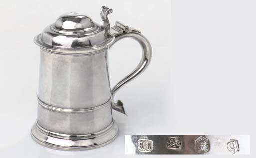 A George II English silver tankard with cover