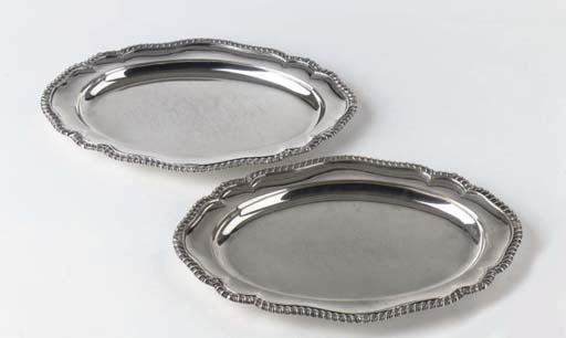 A pair of English silver George III meat-dishes
