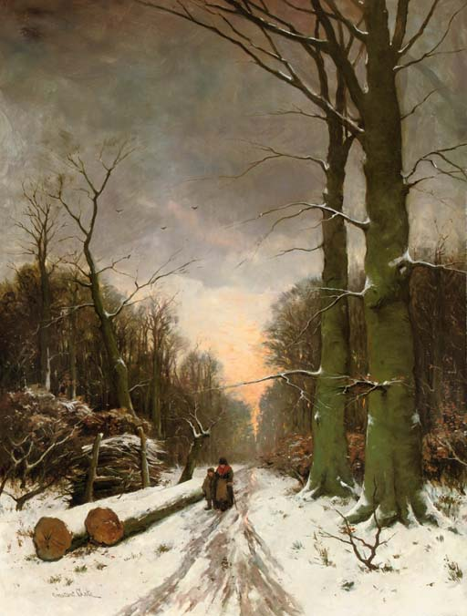 In a snow-covered forest at sunset