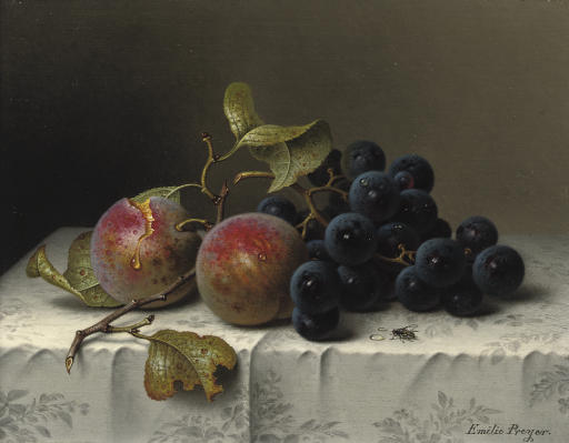 Prunes and grapes on a damast tablecloth
