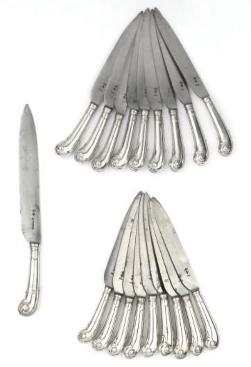 A set of twelve pistol-handled table-knives, a set of six identical table-knives and a carving knife
