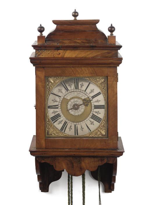 A DUTCH PROVINCIAL WALNUT STRIKING WALL CLOCK (HOOD CLOCK) WITH ALARM
