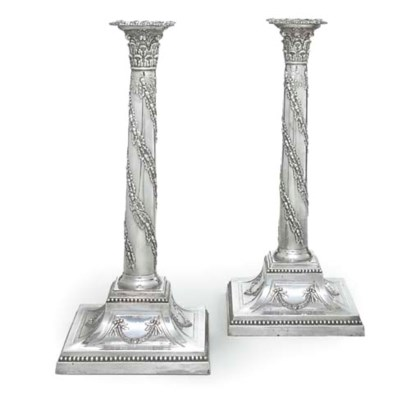 A PAIR OF SILVER-PLATED CANDLE