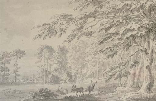 A woodland landscape with deer