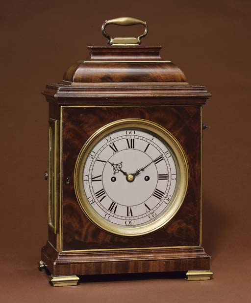A George II mahogany and brass-mounted striking eight day table clock with trip repeat