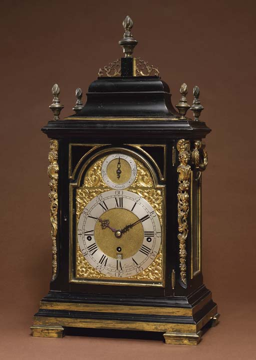 A George III ebonised and gilt-brass mounted ebonised quarter-chiming eight day table clock