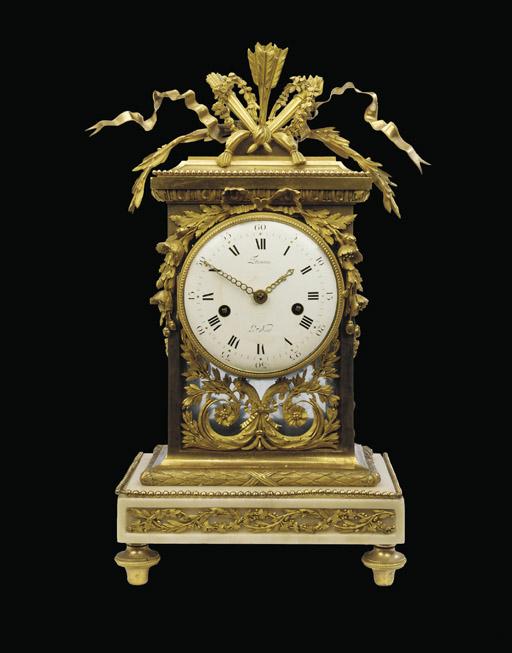 A LATE LOUIS XVI ORMOLU AND MARBLE MANTEL CLOCK