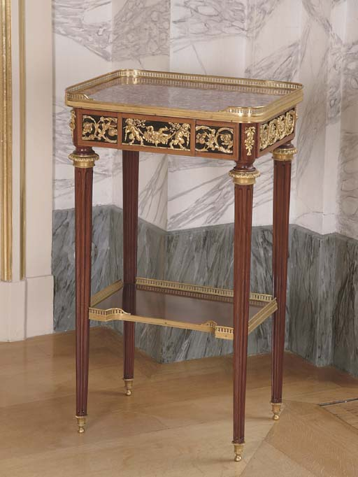 A LOUIS XVI STYLE ORMOLU-MOUNTED MAHOGANY OCCASIONAL TABLE