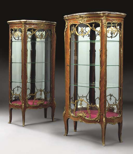 A MATCHED PAIR OF LOUIS XV STYLE ORMOLU-MOUNTED TULIPWOOD BOMBE VITRINES
