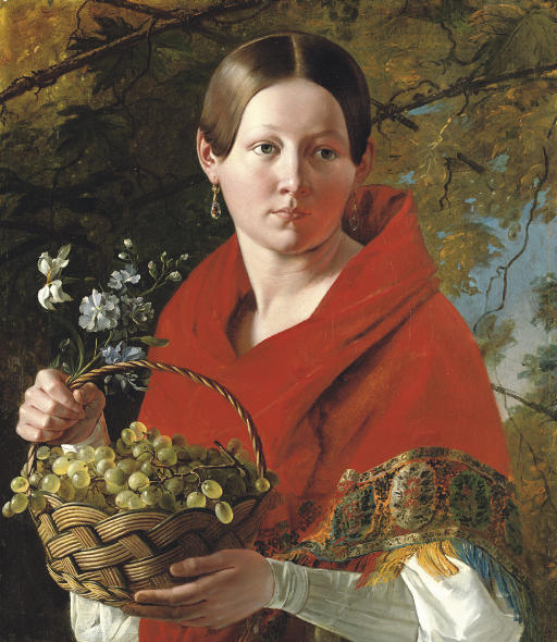 Portrait of a young woman holding a basket of grapes