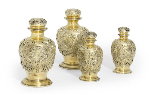 LOUISA, VISCOUNTESS BERESFORD'S TOILET SERVICE A SET OF FOUR GEORGE IV SILVER-GILT DRESSING TABLE-BOTTLES
