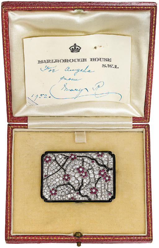 AN EXQUISITE DIAMOND, RUBY AND ONYX BROOCH, BY LACLOCHE