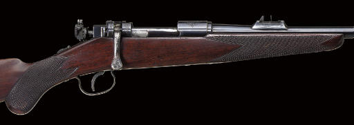 A .250 SPORTING RIFLE BY SAVAGE ARMS CORP., RETAILED BY JOHN RIGBY & CO., NO. 4943
