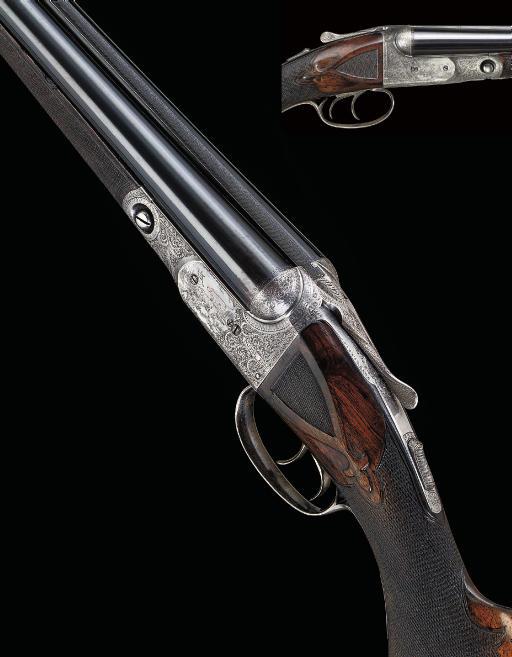 "A FINE 20-BORE ""GRADE 6 MODEL"" BOXLOCK EJECTOR GUN BY PARKER BROS., NO. 214814, WITH INTERCHANGEABLE 20-BORE BARRELS"