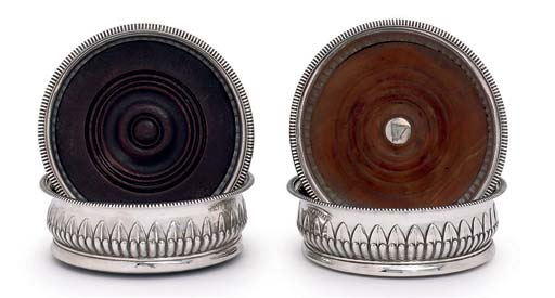 TWO PAIRS OF GEORGE III SILVER WINE COASTERS