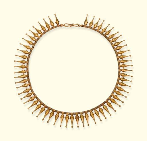 A GOLD REVIVALIST FRINGE NECKLACE, BY JOHN BROGDEN