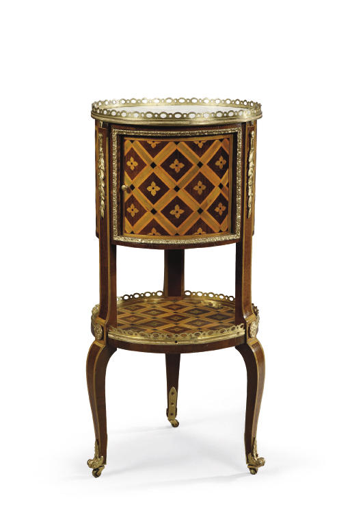 A LATE LOUIS XV ORMOLU-MOUNTED BOIS SATINE, EBONY AND STAINED FRUITWOOD PARQUETRY TABLE DE SALON