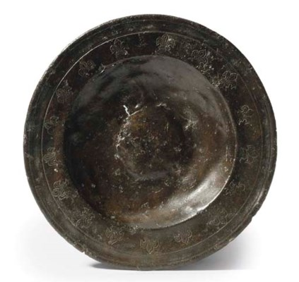 A PEWTER PUNCH-DECORATED SAUCE