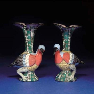 A PAIR OF BIRD CANDLESTICKS