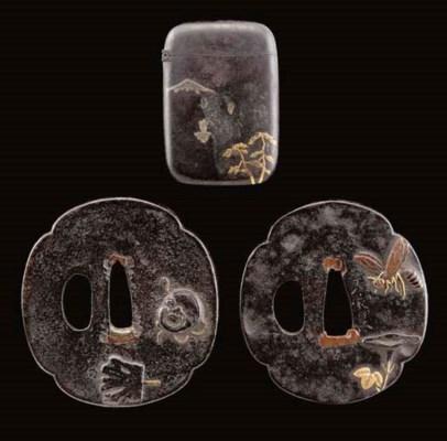 Two Japanese iron lobed quatre