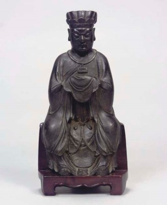 A Chinese bronze seated figure