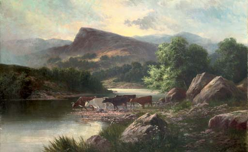 Cows watering in a mountainous river landscape
