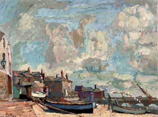 Fishing boats beached before a Cornish village