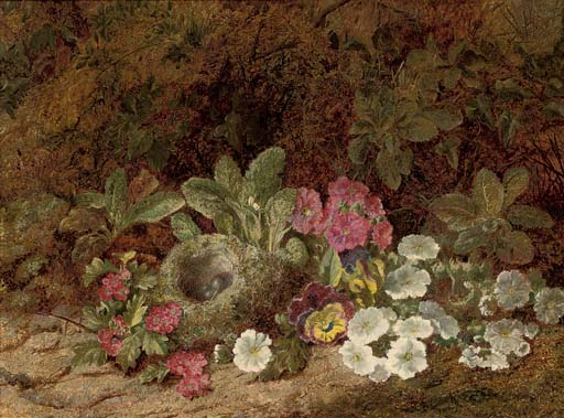 A bird's nest with primulas, pansies and blossom on a mossy bank
