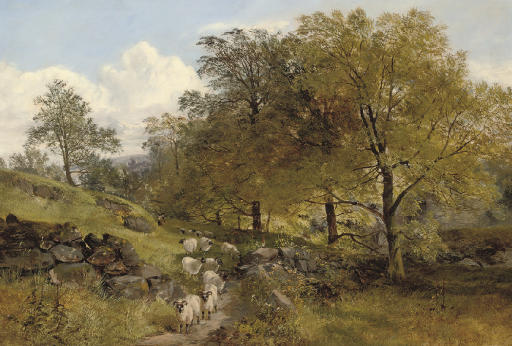 A shepherd and his flock on a country path