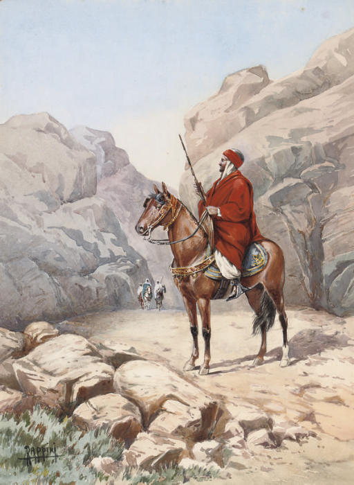 An Arab warrior on horseback in a desert gorge