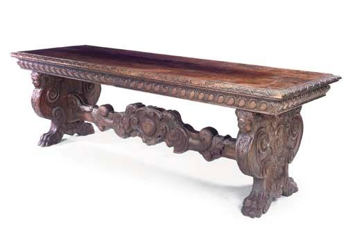 AN ITALIAN WALNUT CENTRE TABLE