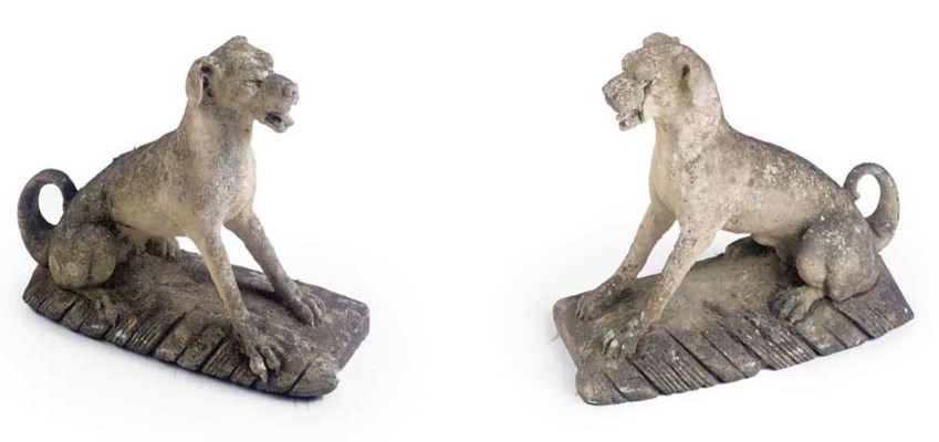 A PAIR OF CARVED STONE HERALDI