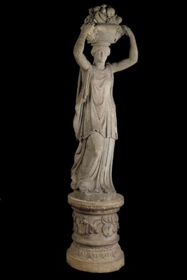 AN ARTIFICIAL STONE FIGURE OF