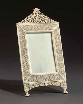 AN INDIAN CARVED IVORY FRAME