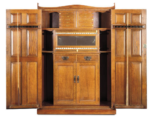 AN EDWARDIAN OAK SNOOKER OR BILLIARDS CABINET
