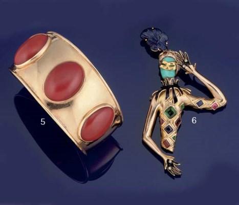 A multi-gem set harlequin broo