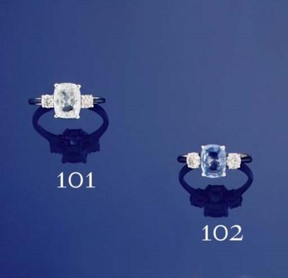 A white sapphire and diamond r